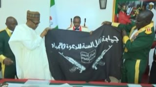 President Buhari Receives Abubakar Shekau's Captured Boko Haram Flag