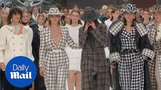 Emotional models walk the runway for Karl Lagerfeld