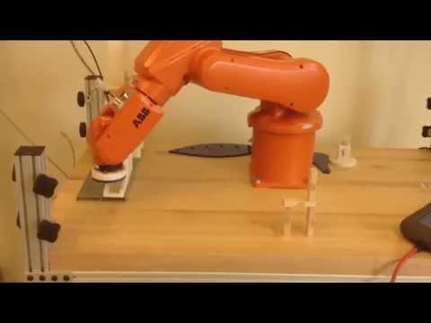 AACC Industrial Robot building a simple Jenga Sculpture