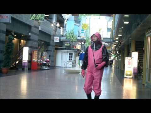 pink rainwear bib-pants and latex in public