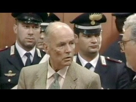Body of Nazi war criminal Erich Priebke at airport in Rome after funeral halted