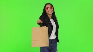 Happy Beautiful Stylish Woman Holding Out Shopping Bag To the Camera | Stock Footage - Videohive