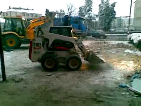 JCB 3CX backhoe loader and bobcat skid steer S 185 at work