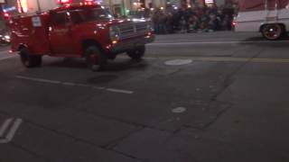 Ghostbusters car and old lacofd squad 51 from tv show in Hollywood Christmas parade
