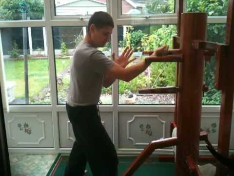 Free practice on wooden dummy. Iron Body Martial Arts. Image 1