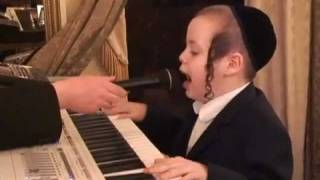 7 Year Old Kid Sings and Plays on Keyboard