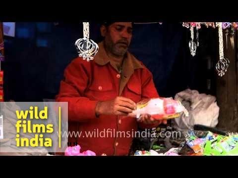 Sikh man sells toys - Anandpur Mela, Punjab