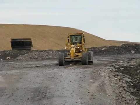 watching a cat 16h grader and passing traffic