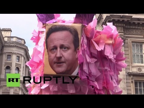 "UK: 'David Cameron out, out, out!"" protesters chant outside Downing St."