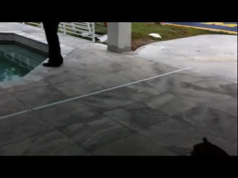 Call today 727- 678 4500 HOW TO LAY TRAVERTINE PAVERS AROUND THE POOL DECK