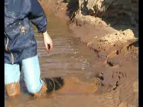 Mud fun with very tall wellies in a clay mine