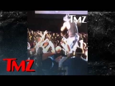 Tim McGraw -- Bitch Slaps Female Fan During Concert