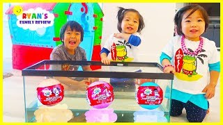 Ryan Emma and Kate Open Surprise Toys in the fish Tank and Learn Colors!