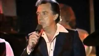 Watch Ray Price Make The World Go Away video