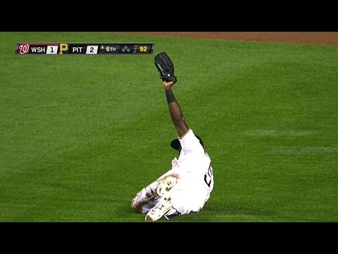 Harrison lays out to make a diving catch