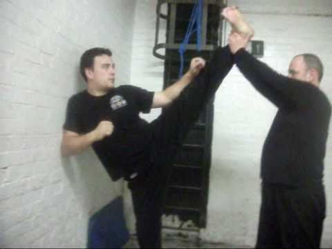 Stretching routine & Practising Explosive Jeet Kune Do kicking drills. Image 1