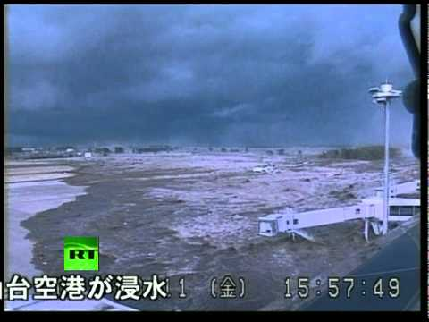 Japan earthquake: CCTV video of tsunami wave hitting airport