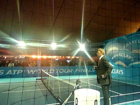 Mark Petchey hitting with coach. Boris Becker commentating