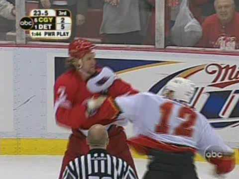 Jarome Iginla vs Derian Hatcher, Mike Commodore vs Darren McCarty Apr 24, 2004 Video
