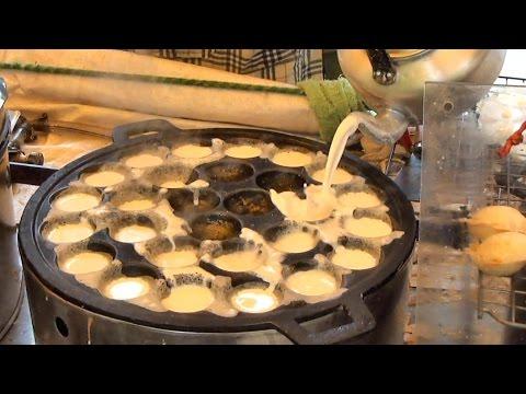 Thai Street Food in Bangkok. Cooking Kanom Krok Coconut Pancakes