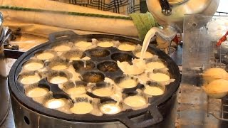 Thai Street Food in Bangkok. Cooking Kanom Krok Coconut Pancakes