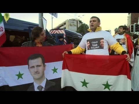 Pro-regime protesters rally outside Syria talks