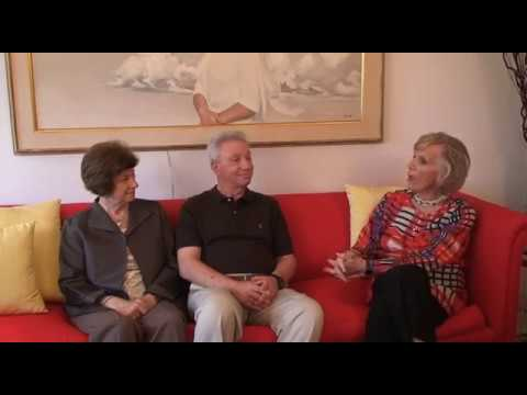 Fred Siegel and his wife Barbara discuss with Elaine Grossinger how they met at Grossinger's Hotel in the Catskills.