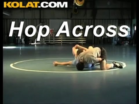KOLAT.COM Wrestling Techniques: Drew Headlee Using Nut Cracker Grip to Hop Across Image 1