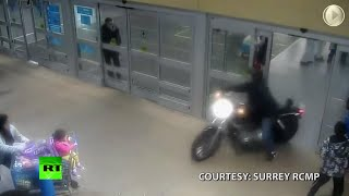 Canadian Rides Through Mall- Motorcycle Cop Chase