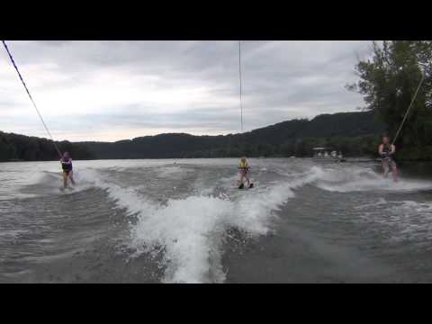 5 year old girl waterskiing with mom and dad