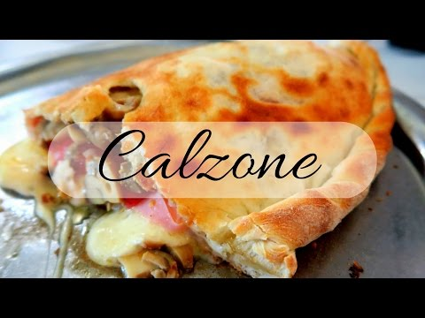 Eating Calzone Pizza in Buenos Aires, Argentina