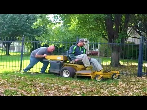 Helping Other LAWN CARE Professional With Mower In MUD