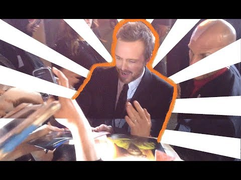 Aaron Paul and Kid Cudi sign autographs for fans at the Need for Speed Premiere