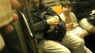 Little girl singing in the subway..