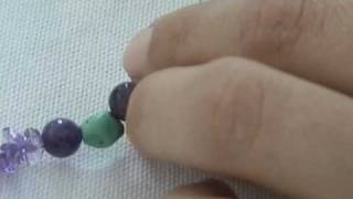 Instructional Video:  Learn how to make a hand knotted necklace.