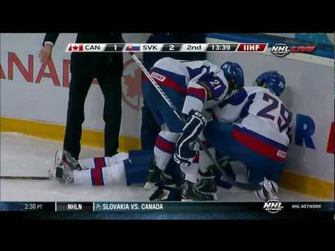 Anthony Camara hits Patrik Luza at the WJC 12/28/12