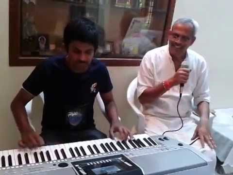 pranav s playing keyboard Radhakrishna Naickji singing Guru...