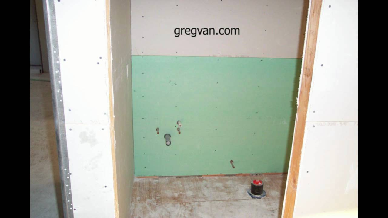 Green Wallboard Behind Toilet And Bathroom Cabinet Home