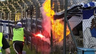 Hooligan dressed as photographer sets fire a flag of guest fans 2013