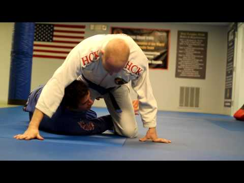 BJJ Half Guard Sweep - Belt Feed To Head Switch Image 1