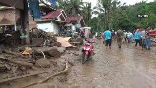 Indonesia flash foods, landslides kill at least 21, destroy hundreds of homes