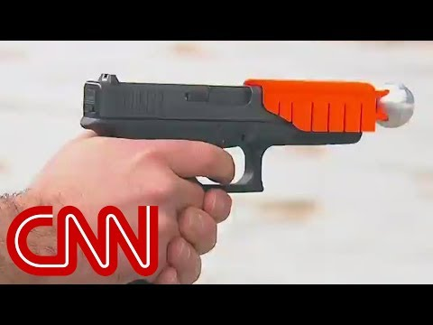 It looks like a toy attachment for a gun, but this new device is intended to give suspects a chance to live if shot. CNN's Sara Sidner reports. More from CNN at http://www.cnn.com/ To license...