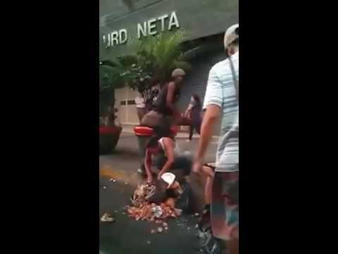 People eating garbage in Venezuela Caracas