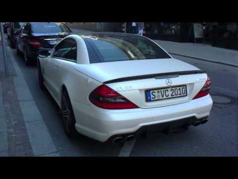 A black Ferrari California and a white Mercedes SL63 AMG with a very