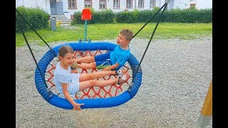 Outdoor playground for kids Playtime fun with swings, slides, trains. Video from KIDS TOYS CHANNEL