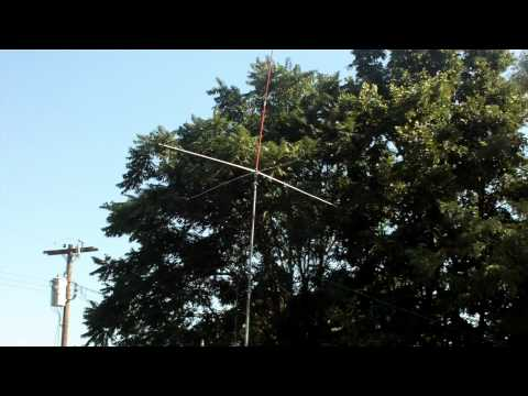 cb antenna antron 99 with a ground plane and a us flag.