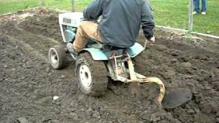 Plowing with sears suburban 12 garden tractor
