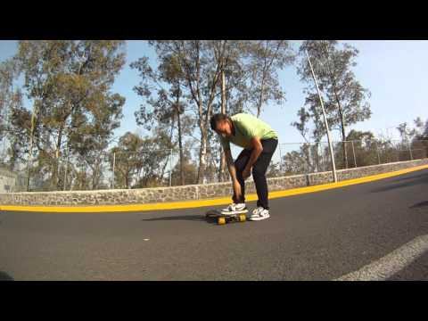Longboarding: Trick tip: Cross legged slide shove it