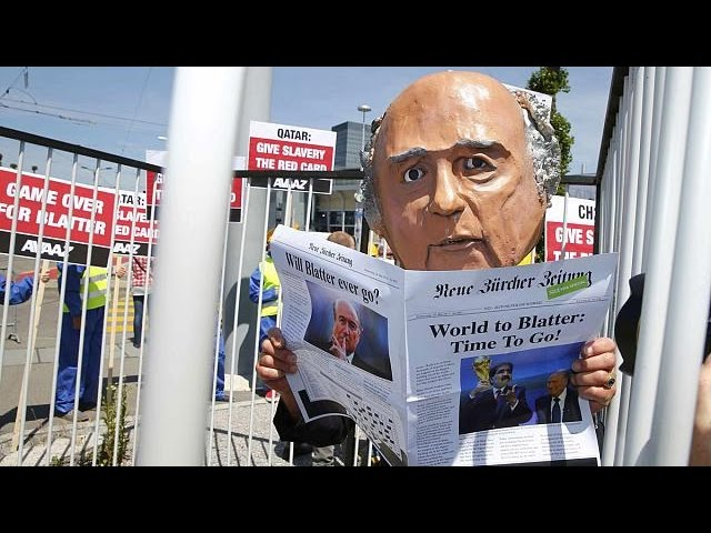 Protesters demand the resignation of FIFA's Blatter - no comment