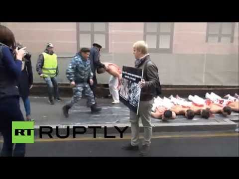 Russia: Moscow students stage BLOODY demo outside Ukrainian Embassy